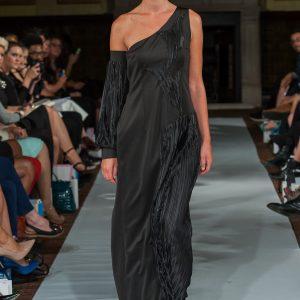 Long black asymmetric pleated dress