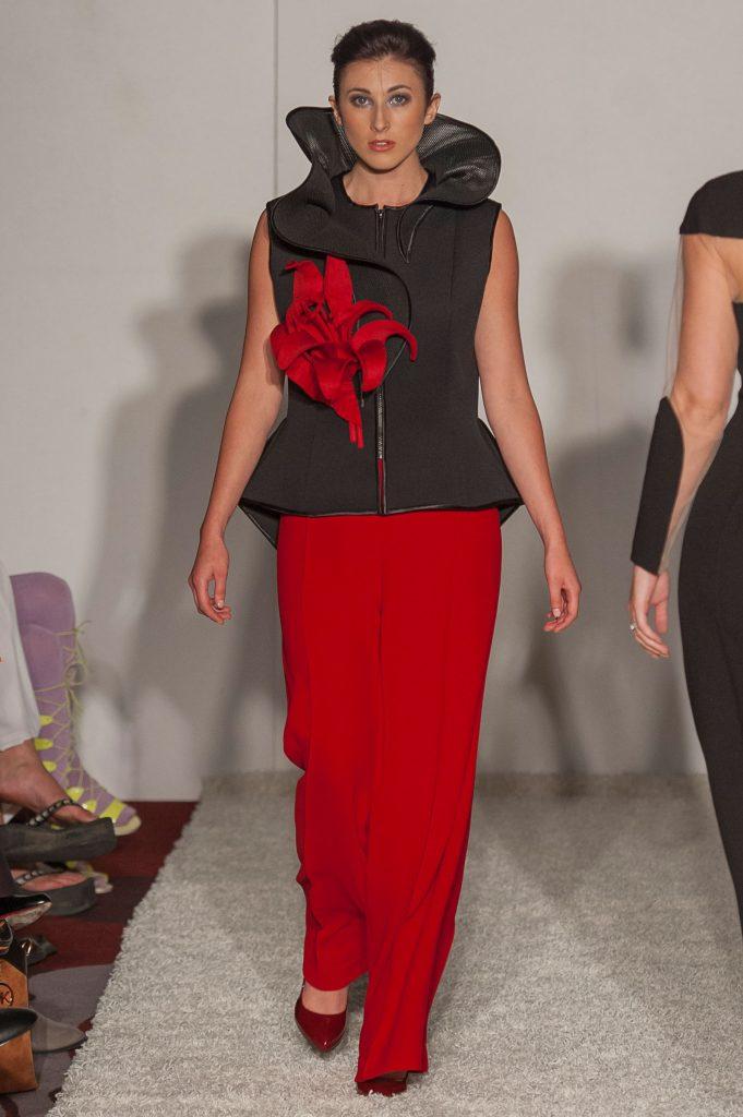 Black neoprene waistcoat with high asymmetric collar, with optional 3d Lily broach